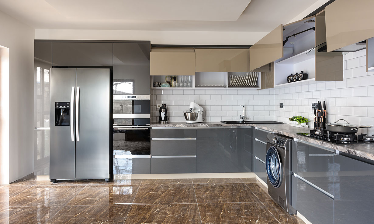 Grey gloss kitchen cabinets along two walls of a kitchen
