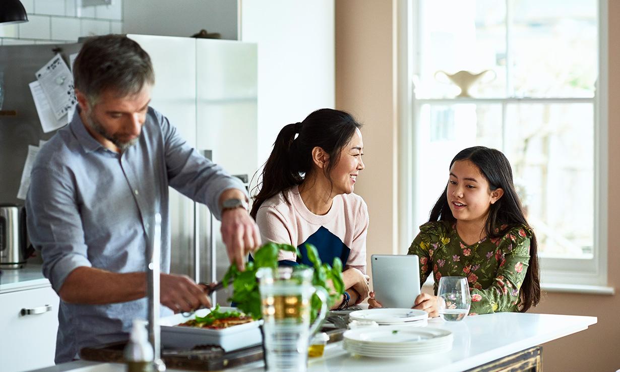 Family sitting around a kitchen table